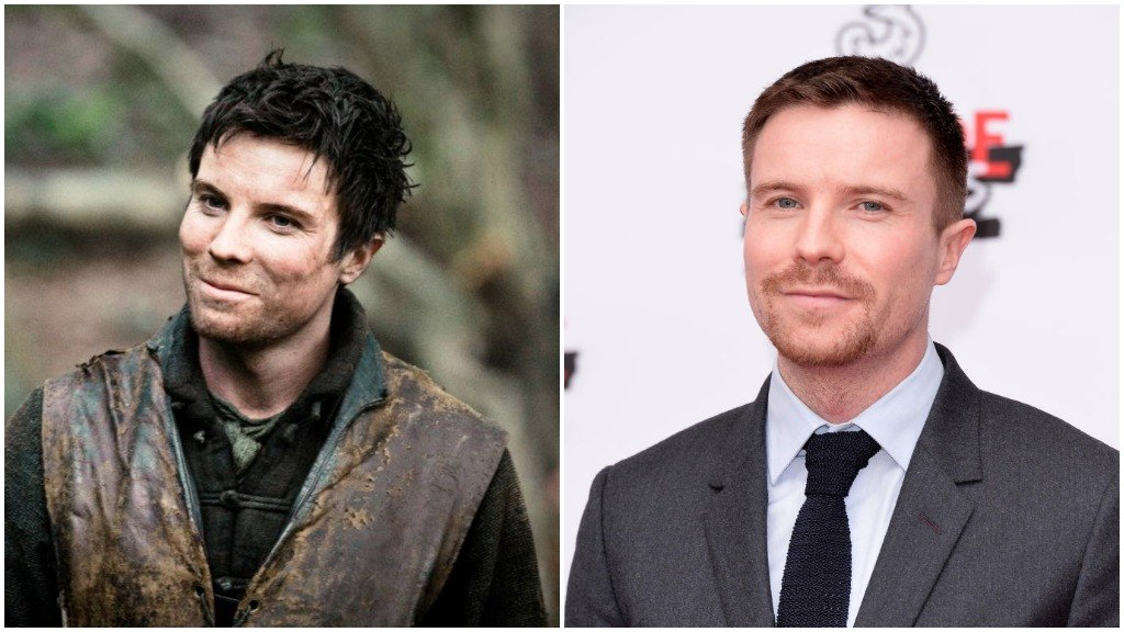 A side-by-side comparison of Joe Dempsie, as Gendry on Game of Thrones, and wearing a suit, sporting a goatee on the red carpet