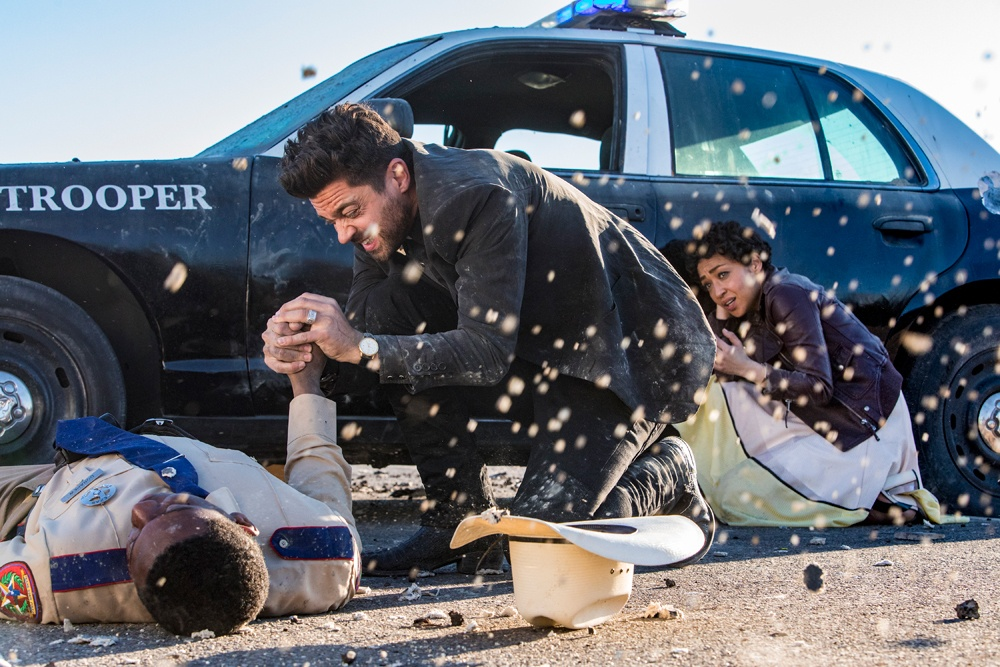 Dominic Cooper fights a sheriff outside of a police car in Preacher