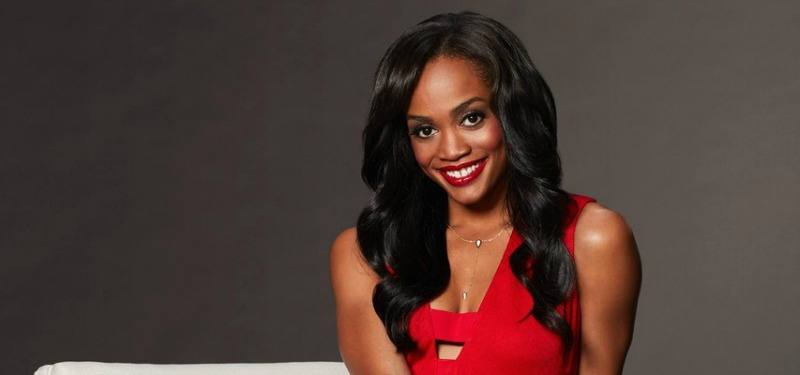 Rachel Lindsay is smiling in a red dress for The Bachelorette.