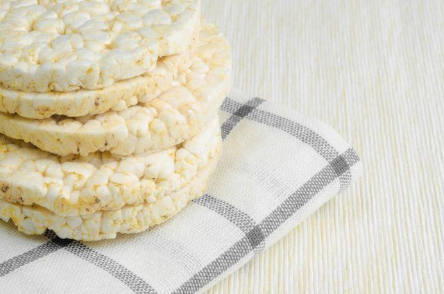 Rice cakes piled on top of each other and placed on a plaid cloth.