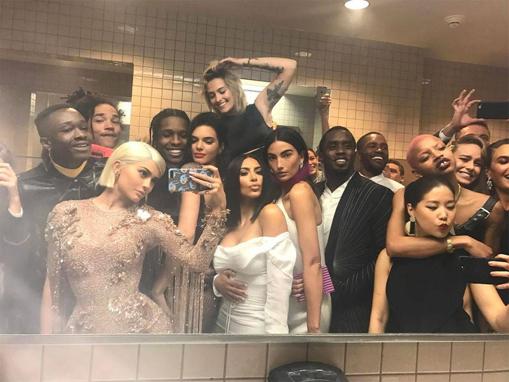 Kylie Jenner takes a selfie of her and a group of celebrity in the bathroom at the Met Gala