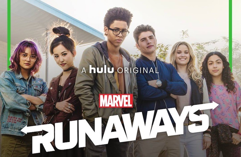 The cast of the Runaways stands together in a line