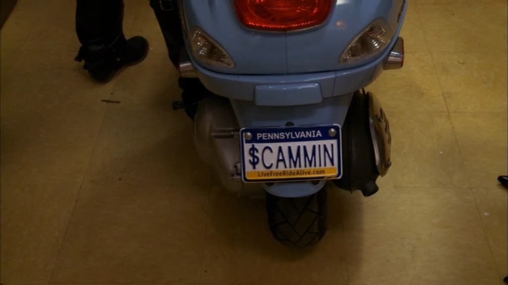 """A license plate reads """"scammin"""" on Sweet Dee's scooter from """"It's Always Sunny in Philadelphia."""""""