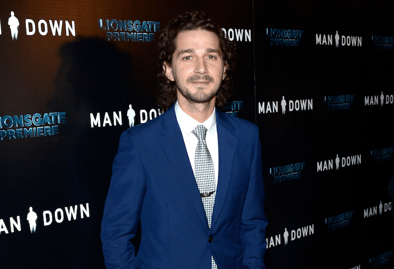 Actor Shia LaBeouf poses in a tux while attending the premiere of Lionsgate Premiere's 'Man Dow