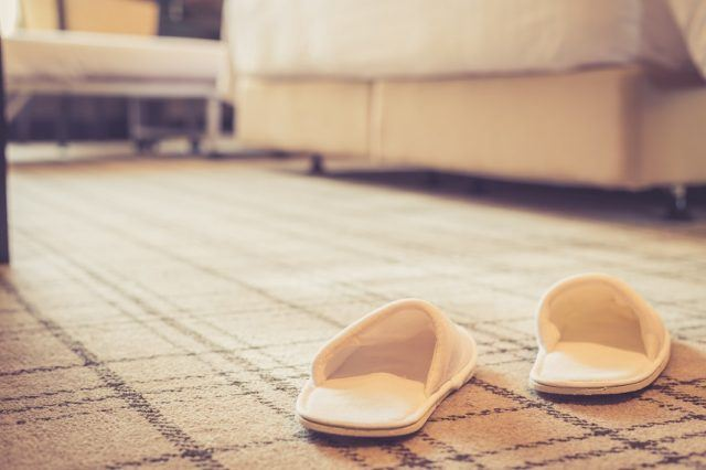 slippers on carpet in hotel room