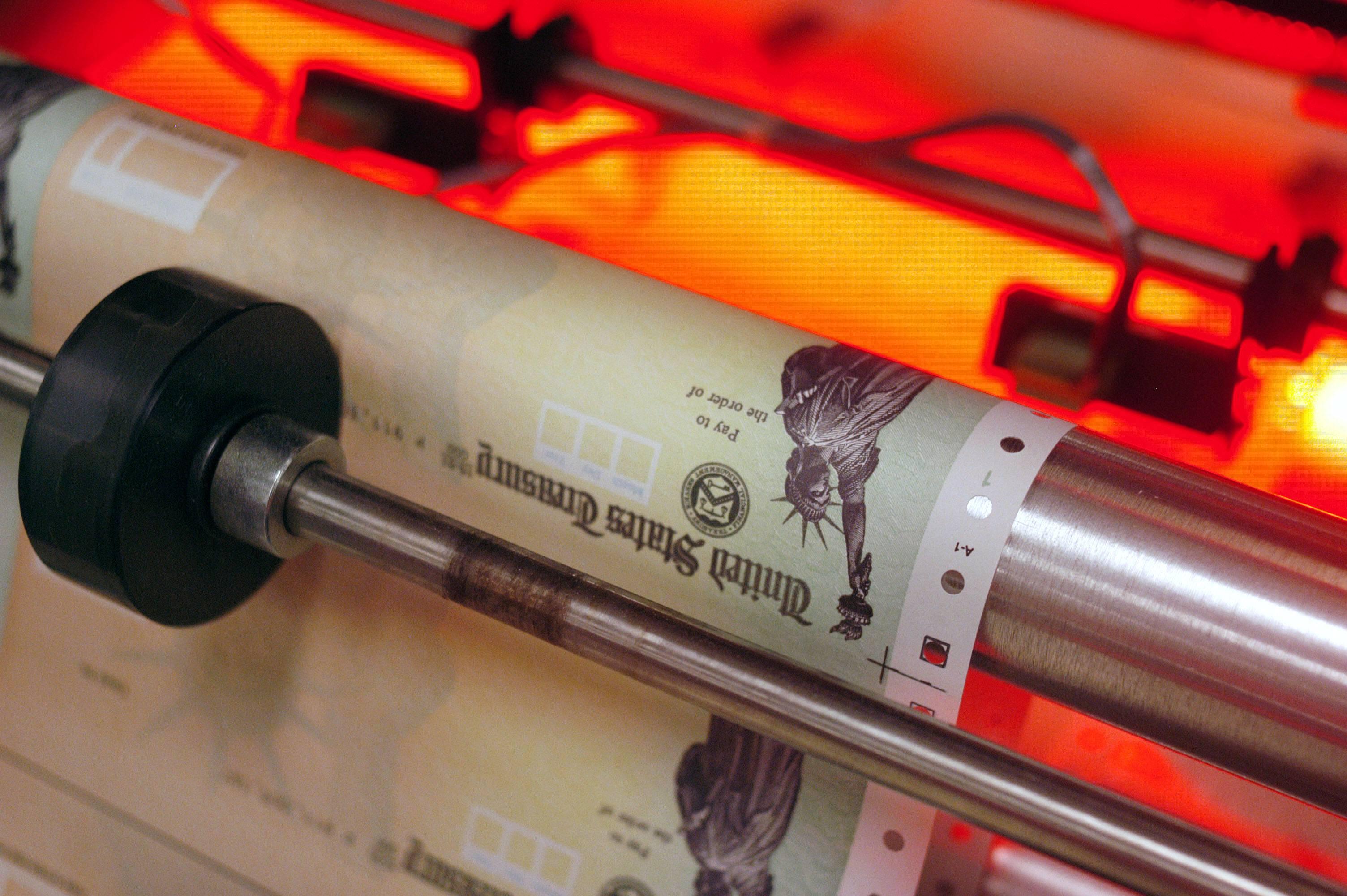 Blank Social Security checks run through a printer at the U.S. Treasury printing facility