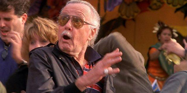 Stan Lee looking up, shocked in a crowd