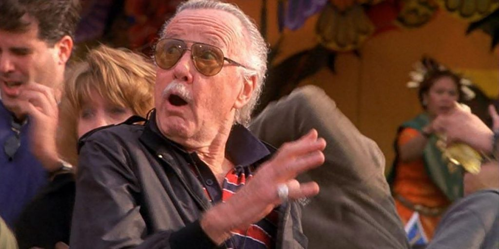Stan Lee looking up, shocked in a crowd
