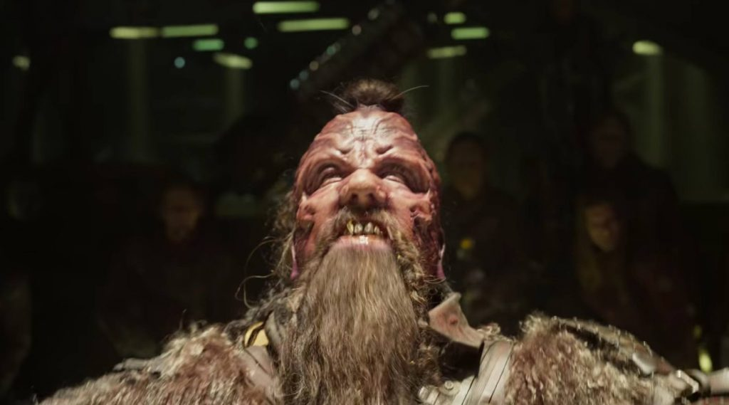 A deformed alien in Guardians of the Galaxy Vol. 2, looking up and glaring