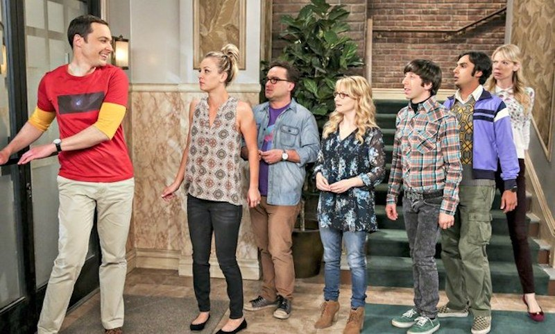 Sheldon Cooper leads his group of friends in a line out the door on  The Big Bang Theory.