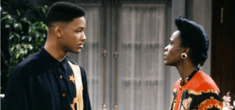 Will Smith and Janet Hubert are looking at each other angrily in The Fresh Prince of Bel-Air.