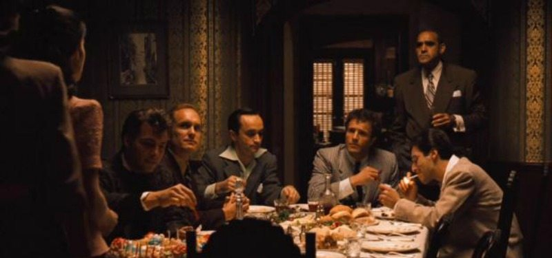 The cast of The Godfather is having dinner together.