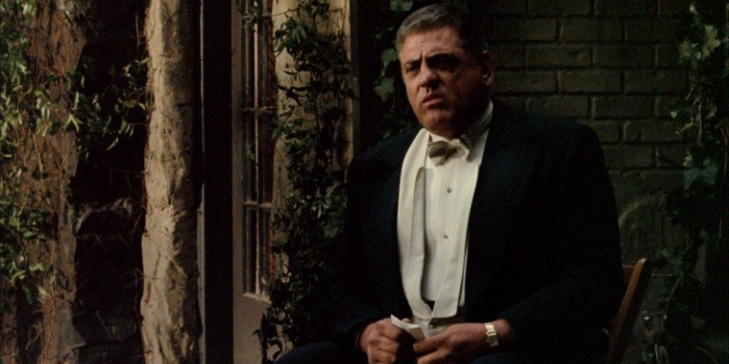 Luca Brasi is sitting down practicing his lines.
