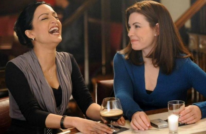 Alicia and Kalinda are sitting at bar together drinking happily.