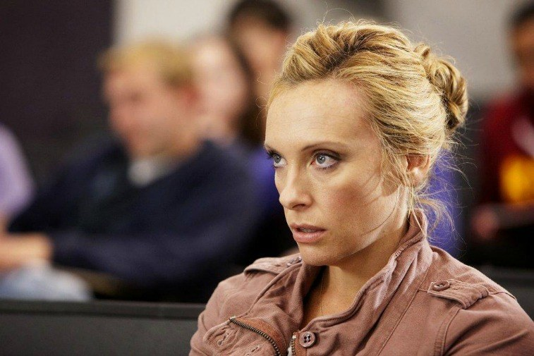 Toni Collette as Tara Gregson in a classroom staring ahead on United States of Tara