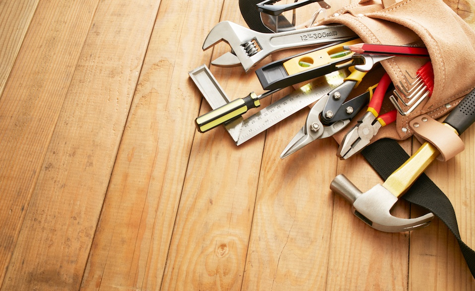 tool belt with tools on wood planks with copy space