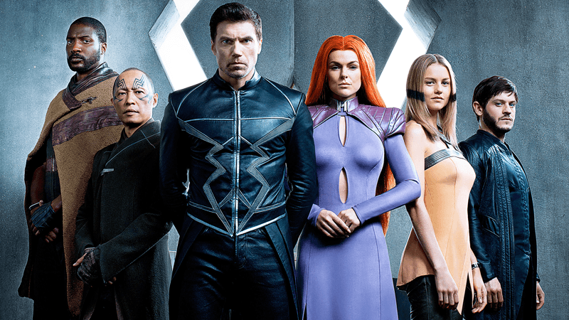 The cast of the Inhumans stand next to each other in line