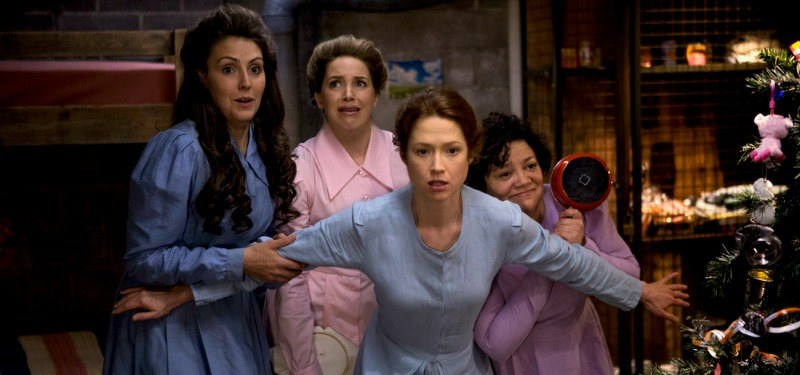 All of the other bunk women hide behind Kimmy in the bunker.