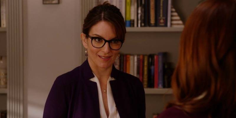 Tina Fey has her hair up and is wearing glasses in Unbreakable Kimmy Schmidt.