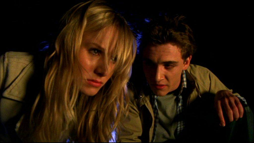 Kristen Bell and Kyle Gallner in the dark