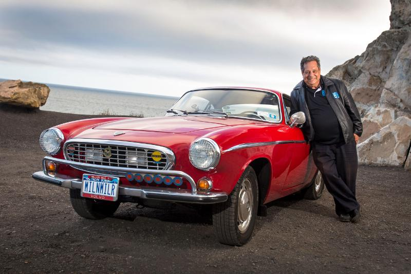 Photo of Irv Gordon and the 1966 Volvo that passed the three-million mile mark