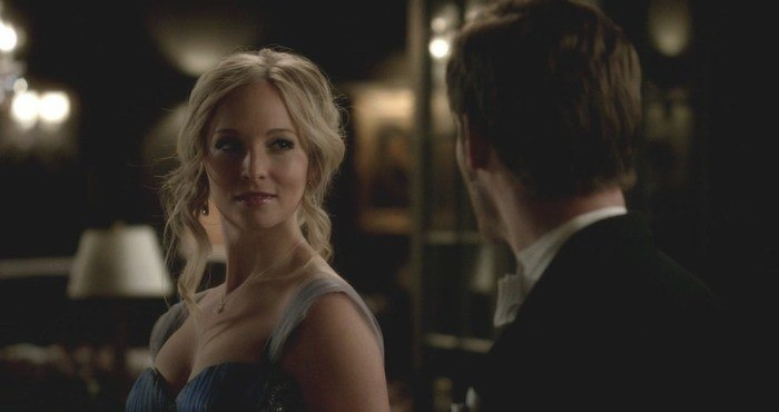 Claire Holt looks at a man in a scene from The Originals