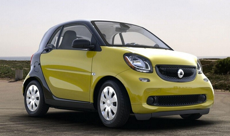 Passenger side view of 2017 Smart fortwo pure coupe in yellow and gray