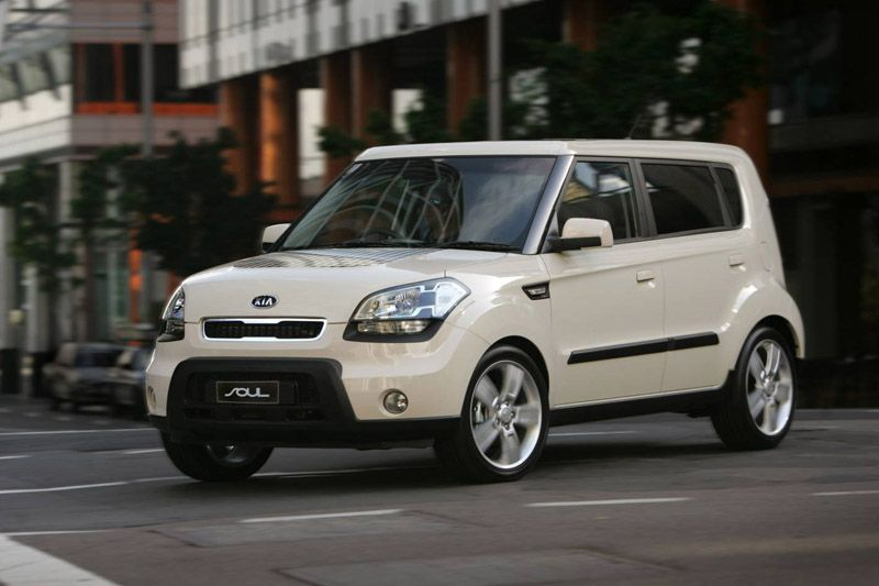 View of cream-colored 2012 Kia Soul on a city street