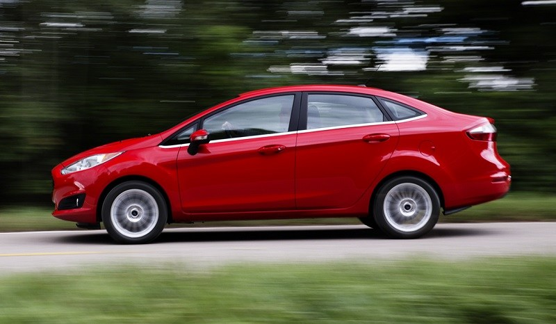 Side view of red Fiesta sedan from 2013 model year