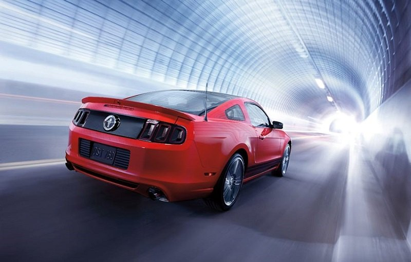 Rear three quarter shot of red 2014 Ford Mustang coupe
