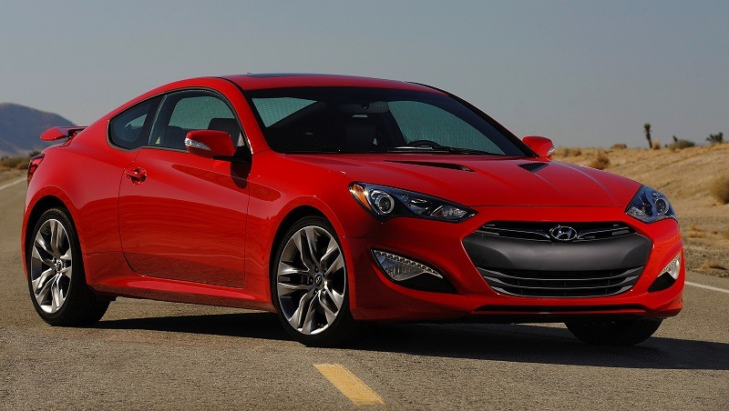 Red Hyundai Genesis coupe seen from front three quarter angle