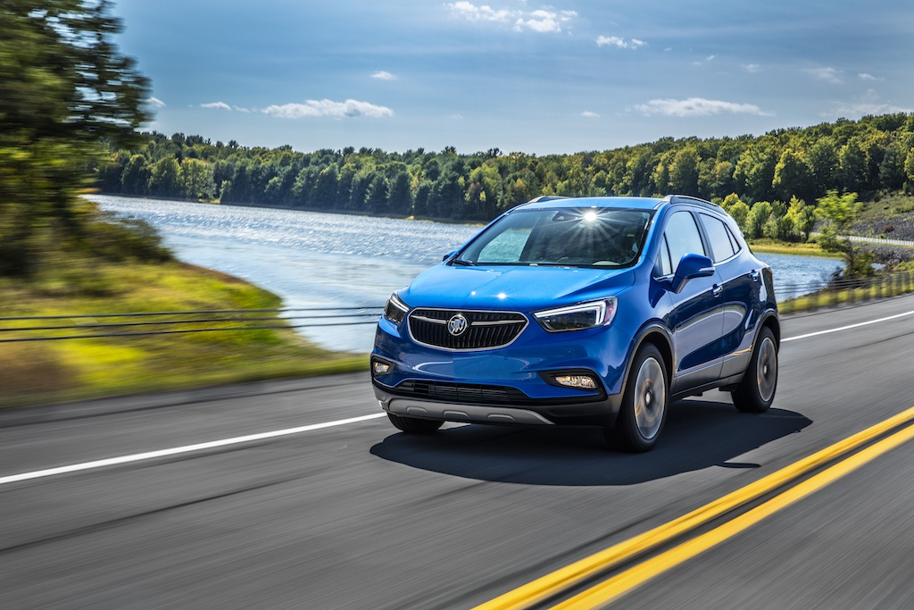 Shot of blue 2017 Buick Encore on the road