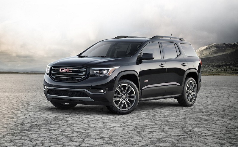 Black 2017 Acadia seen in front three quarter view from driver side