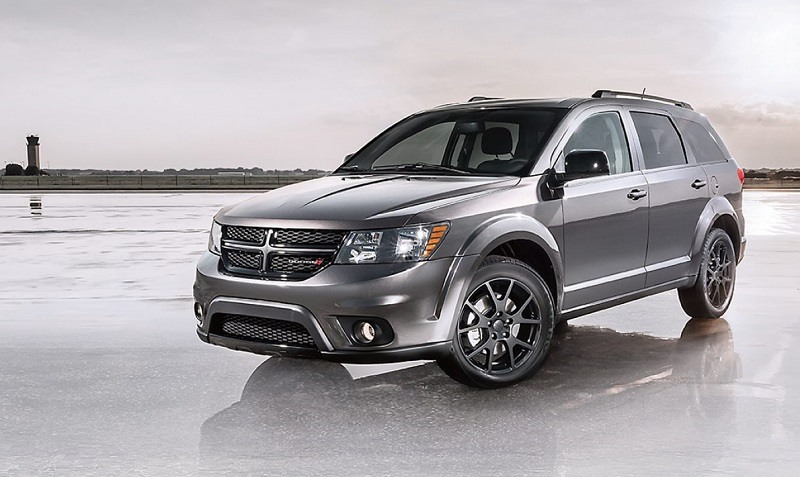 View of gray 2017 Dodge Journey from front three quarter angle