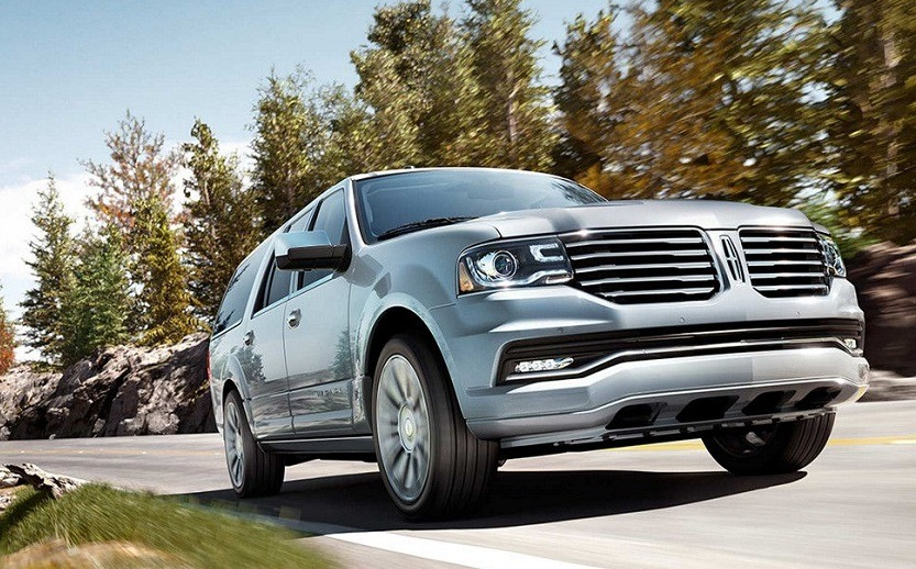 Low-angle view of blue Lincoln Navigator