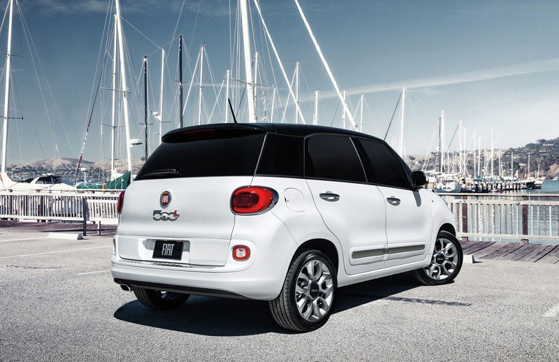 Rear view of whit Fiat 500L parked at a marina