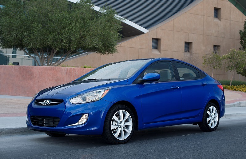 Front three quarter view of blue Accent sedan, model year 2013