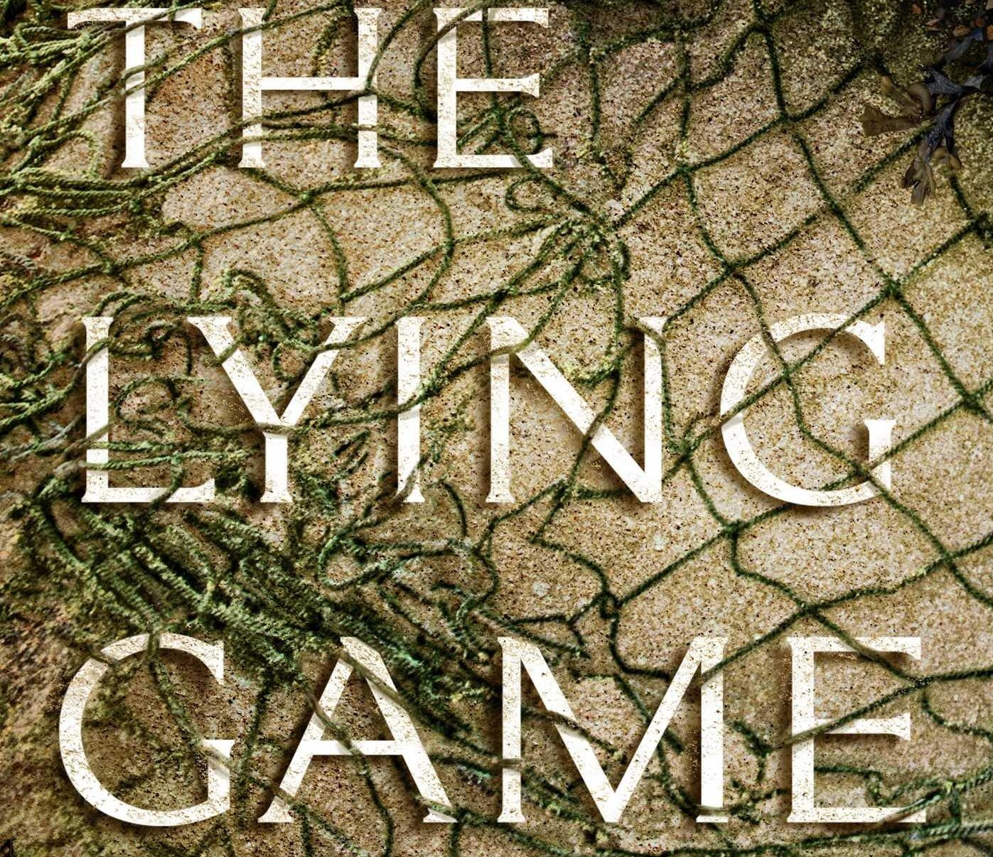 A net in the sand on the cover of The Lying Game