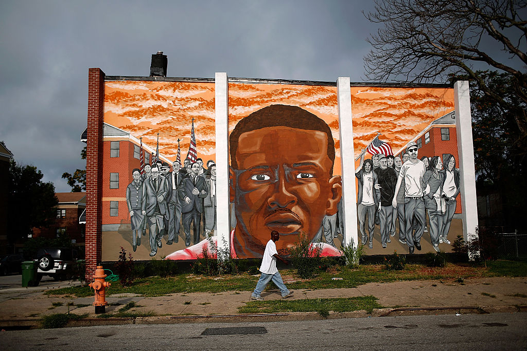 A mural of Freddie Gray near the location where he was arrested