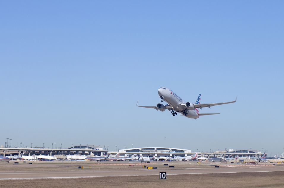 American Airlines airplane taking off at Dallas - Ft Worth (DFW) Airport in Texas.