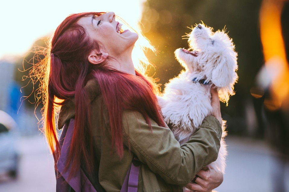 Girl and White Puppy Smiling Together