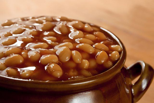 Baked Beans in a brown pot.
