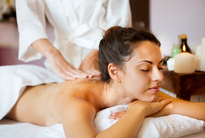 young woman relaxing with massage at spa