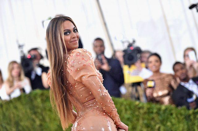 Beyonce poses for photos in a nude gown at the MET Gala.