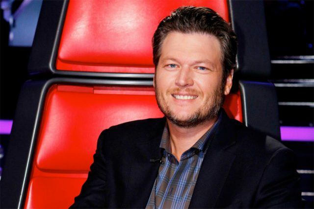 Blake Shelton sits in his coach's chair on The Voice