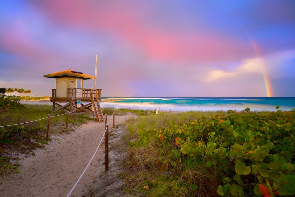 Sunset with rainbow at Boca Raton beach, Florida