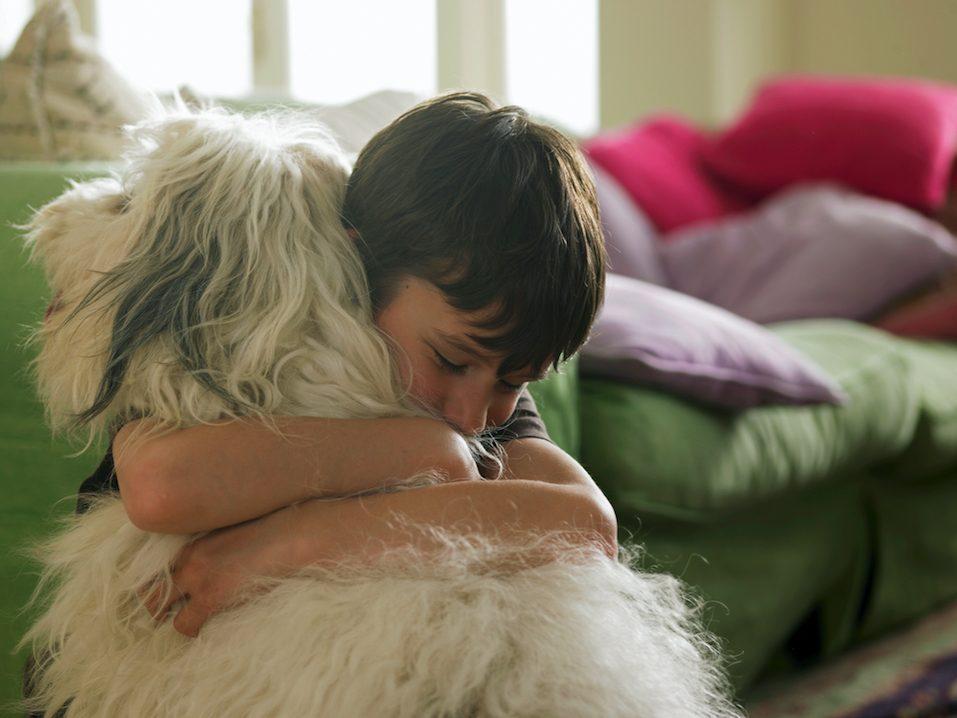 Boy hugging his dog