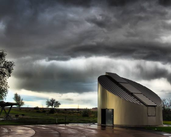 observatory with stormy sky