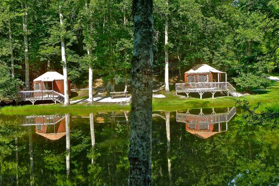 yurts by a pond