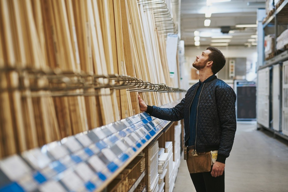 Carpenter selecting wood in a hardware store